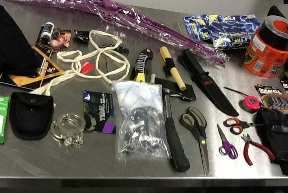 The Los Angeles Police Department unveiled Friday some of the items, including a hatchet and knives, seized from the luggage of Yongda Huang Harris who was arrested while trying to enter the United States. / LAPD