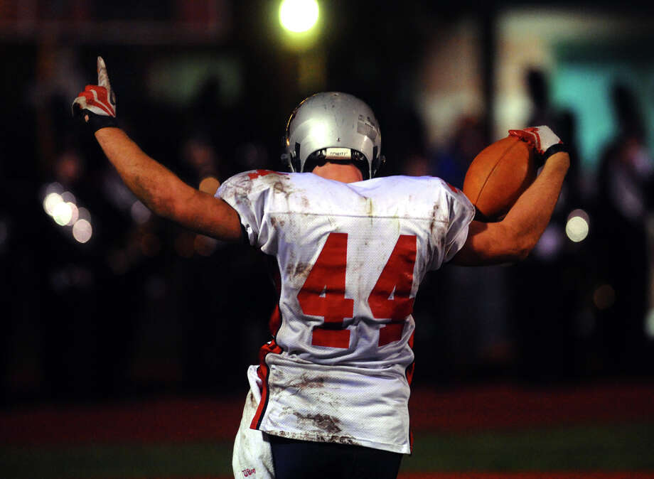 New Fairfield's #44 Nick Preble points skyward after scoring a touchdown, during boys football action against Masuk in Monroe, , Conn. on Friday October 12, 2012. Photo: Christian Abraham / Connecticut Post