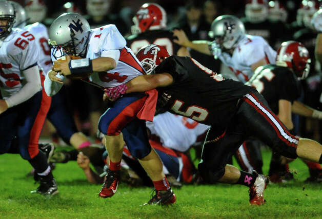 Masuk's #95 Bryan Monaco tackles New Fairfield QB Mike Jamieson, during boys football action in Monroe, , Conn. on Friday October 12, 2012. Photo: Christian Abraham / Connecticut Post
