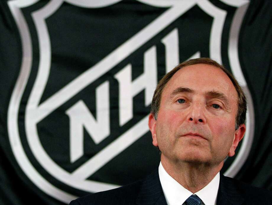 FILE - In this Sept. 13, 2012, file photo, NHL hockey commissioner Gary Bettman listens as he meets with reporters after a meeting with team owners, in New York. The NHL locked out its players at midnight Saturday, becoming the third major sports league to impose a work stoppage in the last 18 months. The action also marks the fourth shutdown for the NHL since 1992, including a year-long dispute that forced the cancellation of the entire 2004-05 season when the league held out for a salary cap. The deal which ended that dispute expired at midnight, and Commissioner Gary Bettman followed through on his longstanding pledge to lock out the players with no new agreement in place.  (AP Photo/Mary Altaffer, File) Photo: Mary Altaffer / AP