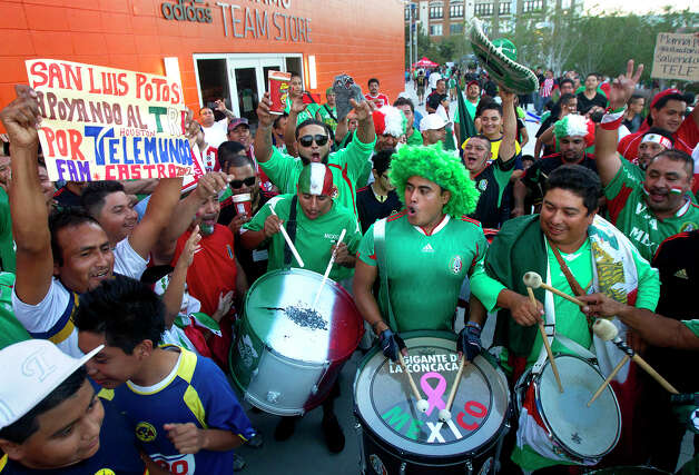 Mexico fans show their support before the FIFA World Cup qualifying match against Guyana at BBVA Compass Stadium Friday, Oct. 12, 2012, in Houston. Photo: Cody Duty, Houston Chronicle / © 2012 Houston Chronicle