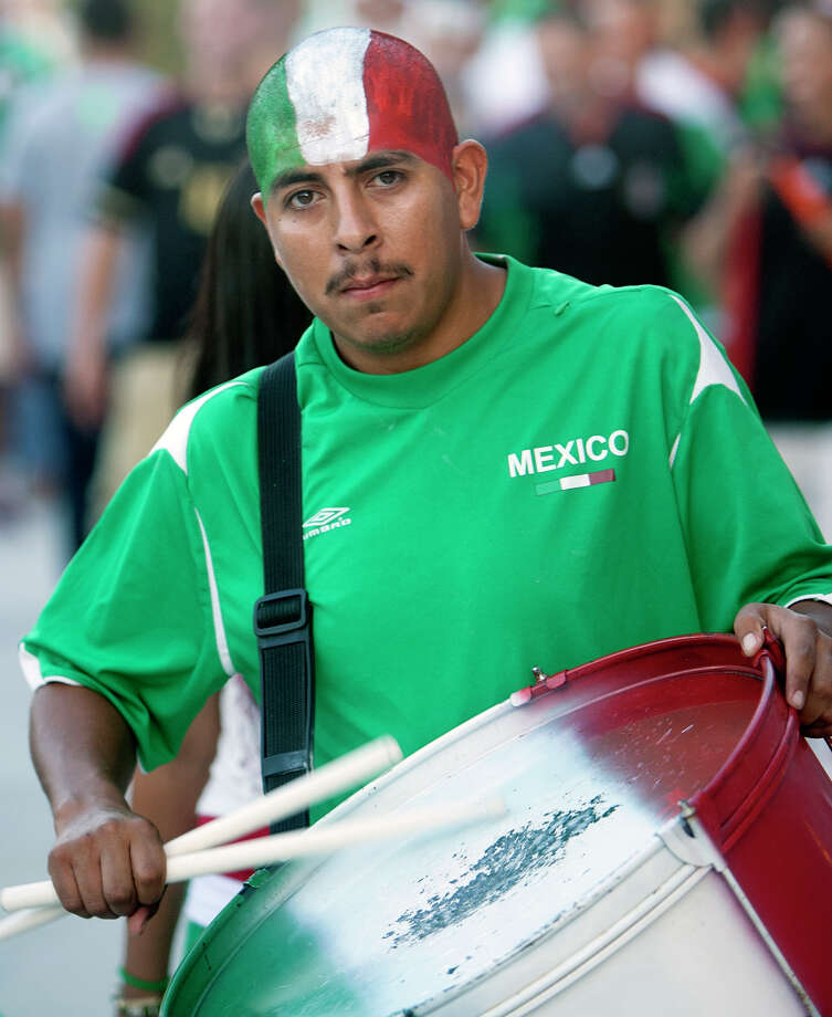 Santos Zambrano plays a drum before the FIFA World Cup qualifying match against Guyana at BBVA Compass Stadium Friday, Oct. 12, 2012, in Houston. Photo: Cody Duty, Houston Chronicle / © 2012 Houston Chronicle
