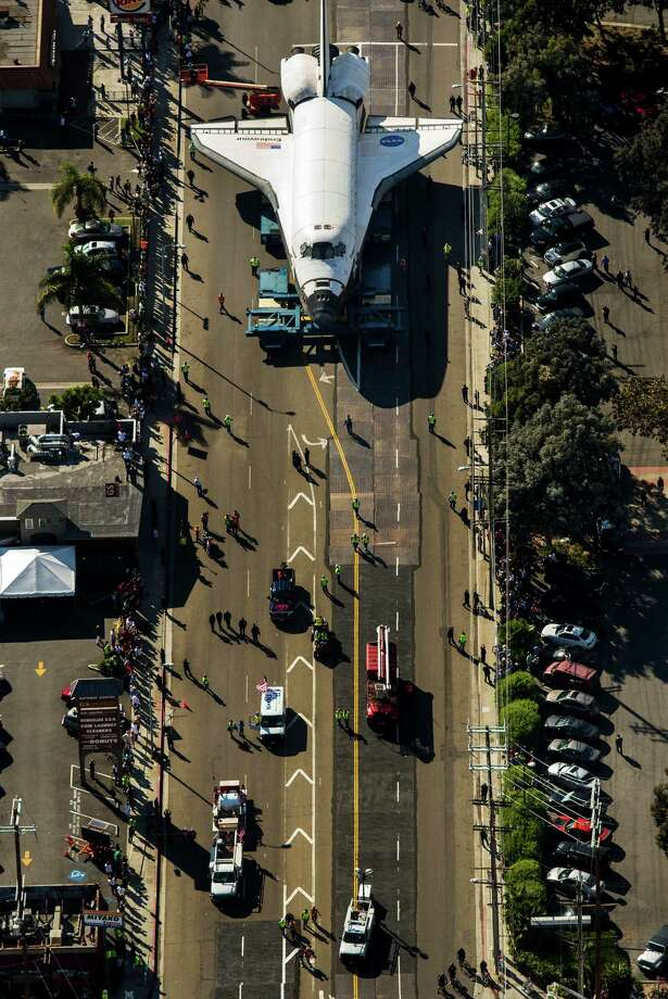 People line the street to look at the space shuttle Endeavour as it makes its way through Los Angles, California, on the way to a museum on Friday, October 12, 2012. (Jay L. Clendenin/Los Angeles Times/MCT) Photo: Jay L. Clendenin, McClatchy-Tribune News Service / Los Angeles Times