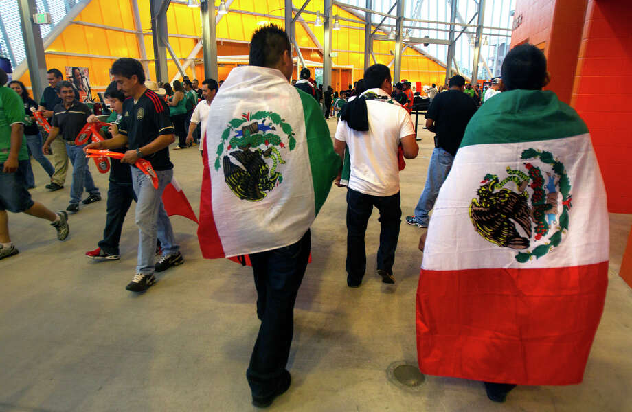 Mexico fans walk through BBVA Compass Stadium before the FIFA World Cup qualifying match against Guyana at BBVA Compass Stadium Friday, Oct. 12, 2012, in Houston. Photo: Cody Duty, Houston Chronicle / © 2012 Houston Chronicle
