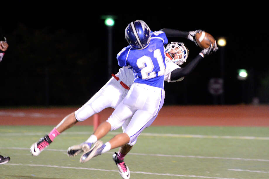 Greenwich #1 Vincent Ferraro reaches for a pass as Fairfield Ludlowe High School hosts Greenwich High School in varsity football in Fairfield, CT on Oct. 12, 2012. Photo: Shelley Cryan / Shelley Cryan for the CT Post/ freelance Shelley Cryan