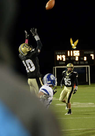 Trumbull's Mike Williams (10) jumps up to receive a pass during the football game against Darien at Trumbull High School on Friday, Oct. 12, 2012. Photo: Amy Mortensen / Connecticut Post Freelance