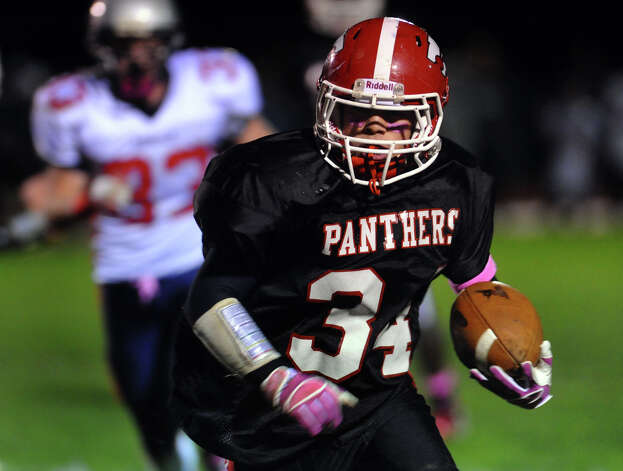Masuk's #34 Frank Bacarella carries the ball towards the endzone, during boys football action against New Fairfield in Monroe, , Conn. on Friday October 12, 2012. Photo: Christian Abraham / Connecticut Post