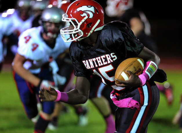 Masuk QB Maik Cummings carries the ball, during boys football action against New Fairfield in Monroe, Conn. on Friday October 12, 2012. Photo: Christian Abraham / Connecticut Post