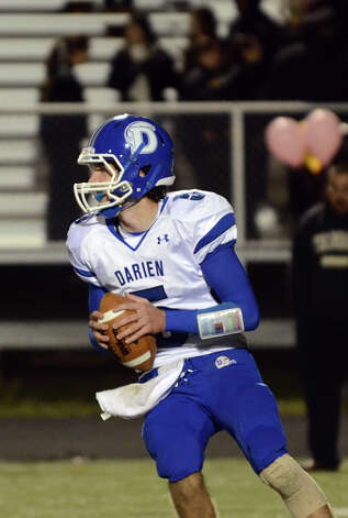Darien's Henry Baldwin (5) looks to pass during the football game against Trumbull at Trumbull High School on Friday, Oct. 12, 2012. Photo: Amy Mortensen / Connecticut Post Freelance