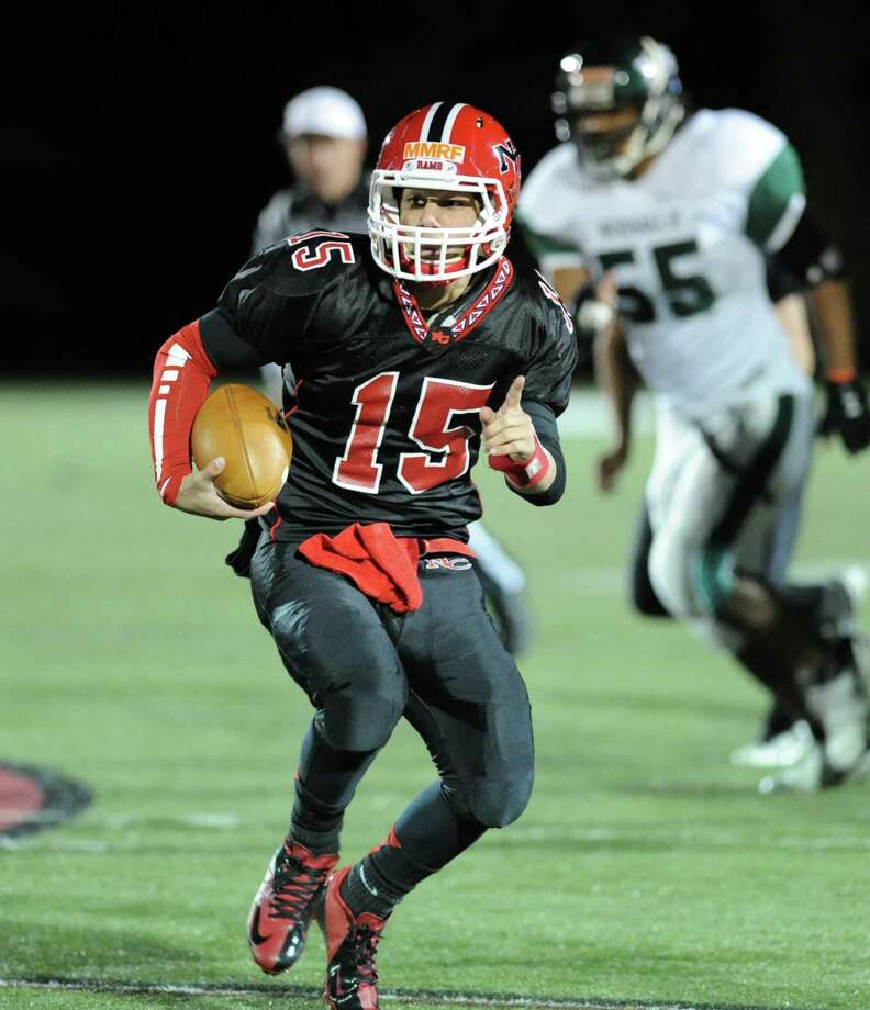 New Canaan quarterback Nick Cascione # 15 on a running play during the high School football game between New Canaan High School and Norwalk High School at New Canaan, Friday night, Oct. 12, 2012. Photo: Bob Luckey / Greenwich Time