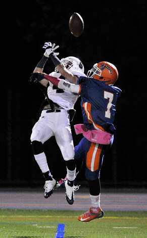 Danbury's Corey Chaffee breaks up a touchdown pass intended for Staples' James Frusciante during their game at Danbury High School on Friday, Oct. 12, 2012. Staples won, 51-6. Photo: Jason Rearick / The News-Times