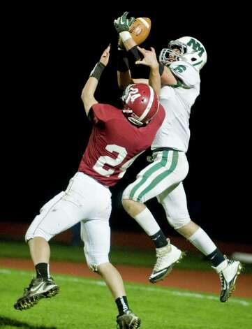 Bethel High School's Nick Silva tries to disrupt a reception by New Milford High School's Kameron Bradshaw in a game at Bethel. Friday, Oct. 12, 2012 Photo: Scott Mullin / The News-Times Freelance