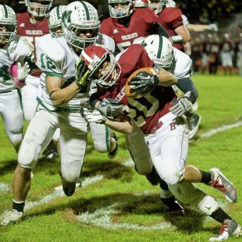 New Milford High School's Matt Sheehy hits Bethel High School's James Giannone in a game at Bethel. Friday, Oct. 12, 2012 Photo: Scott Mullin