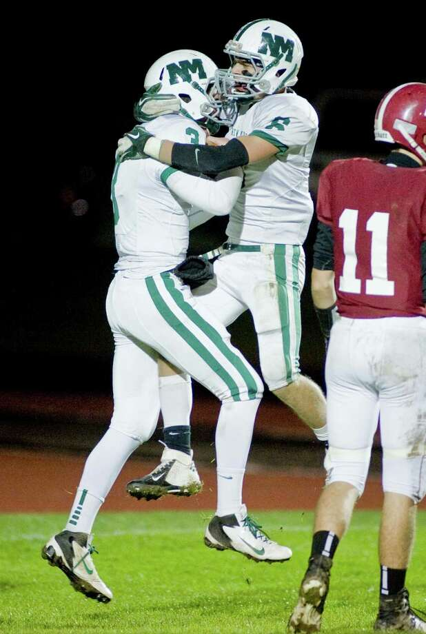 New Milford High School's Connor Shanahan, left, and Kameron Bradshaw celebrate a touchdown against Bethel High School in a game at Bethel. Friday, Oct. 12, 2012 Photo: Scott Mullin