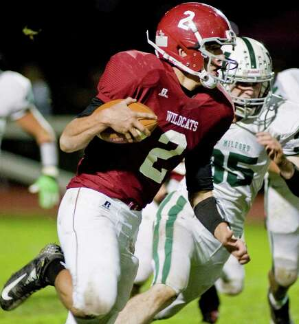 Bethel High School quarterback Joseph Piatnik carrying the ball against New Milford High School during a football game at Bethel. Friday, Oct. 12, 2012 Photo: Scott Mullin / The News-Times Freelance