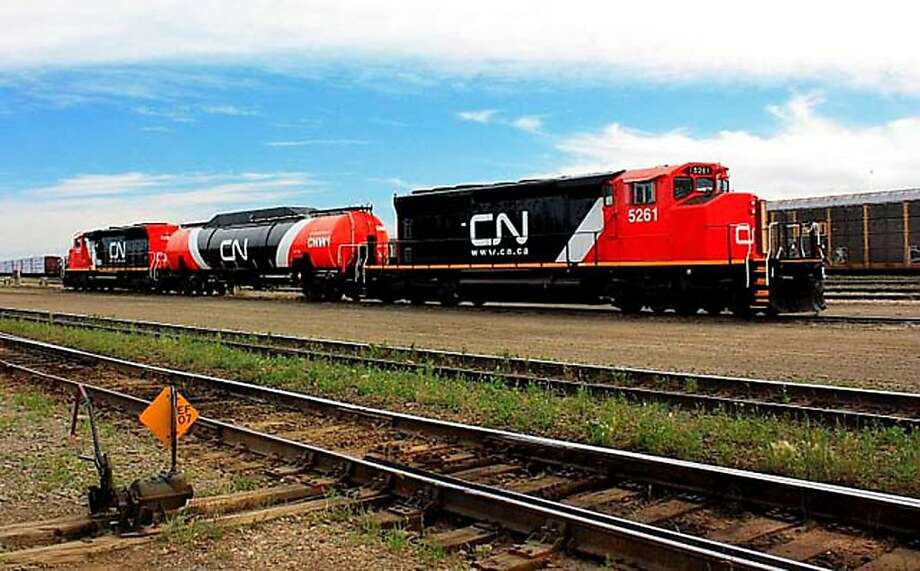 The Canadian National Railway is experimenting with natural gas as a train fuel, which involves adding a liquefied natural gas tank behind the locomotive. The switch from diesel could save money. Photo: Canadian National Railway