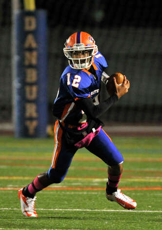Danbury quarterback Anferny Ith scrambles with the ball during their game against Staples at Danbury High School on Friday, Oct. 12, 2012. Staples won, 51-6. Photo: Jason Rearick / The News-Times