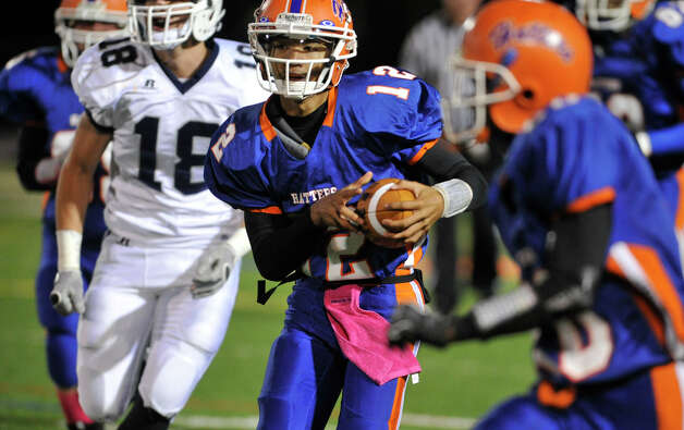 Danbury quarterback Anferny Ith runs with the ball during their game against Staples at Danbury High School on Friday, Oct. 12, 2012. Staples won, 51-6. Photo: Jason Rearick / The News-Times