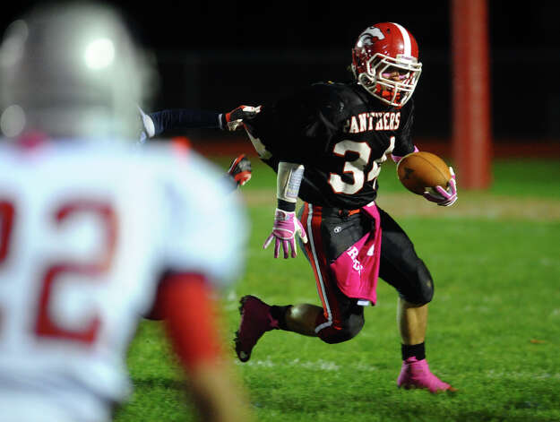 Masuk's #34 Frank Bacarella carries the ball, during boys football action against New Fairfield in Monroe, Conn. on Friday October 12, 2012. Photo: Christian Abraham / Connecticut Post
