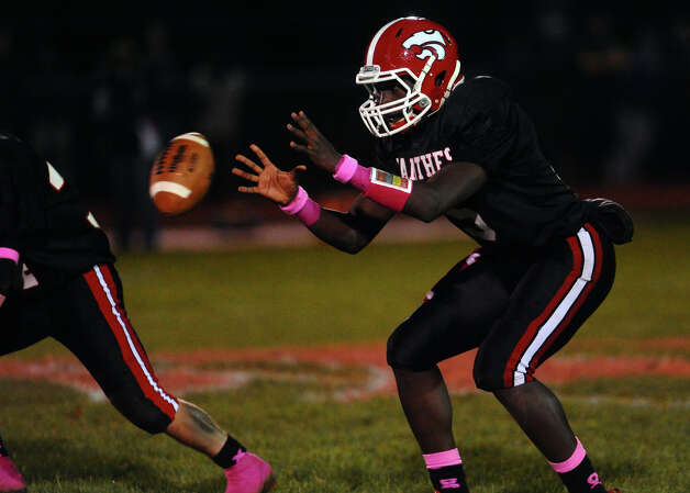 Masuk QB Maik Cummings, during boys football action against New Fairfield in Monroe, Conn. on Friday October 12, 2012. Photo: Christian Abraham / Connecticut Post