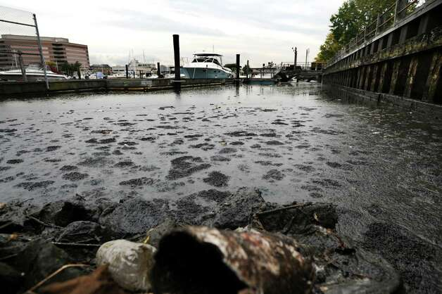 A large sewage spill created a big mess and spread throughout the upper part of the East Branch of the Harbor around Czescik Marina and the nearby city wastewater treatment plant in Stamford, Conn. on Friday, Oct. 12, 2012. The spill appears too large to contain and when the tide turns, the floating, stinking mounds of effluent will be swept into the Sound. Photo: Cathy Zuraw / Stamford Advocate
