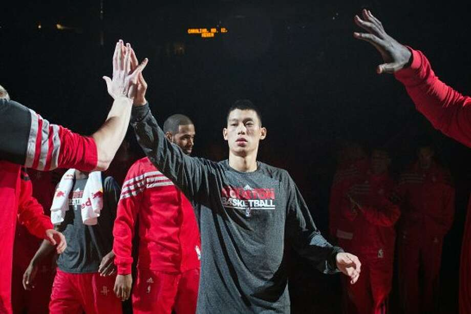 Rockets guard Jeremy Lin takes the court during introductions before taking on the Hornets. (Smiley N. Pool / © 2012  Houston Chronicle)
