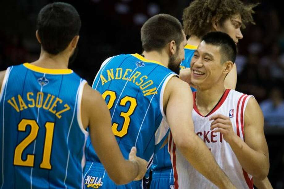 Rockets guard Jeremy Lin hugs Hornets forward Ryan Anderson. (Smiley N. Pool / © 2012  Houston Chronicle)