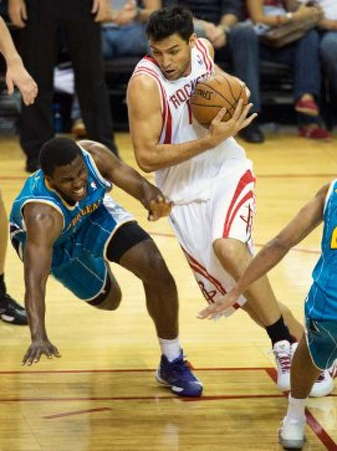 Rockets guard Carlos Delfino drives past Hornets forward Darius Miller. (Smiley N. Pool / © 2012  Houston Chronicle)