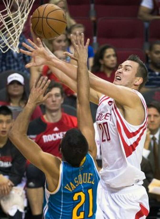 Rockets forward Donatas Motiejunas fights for a rebound. (Smiley N. Pool / © 2012  Houston Chronicle)