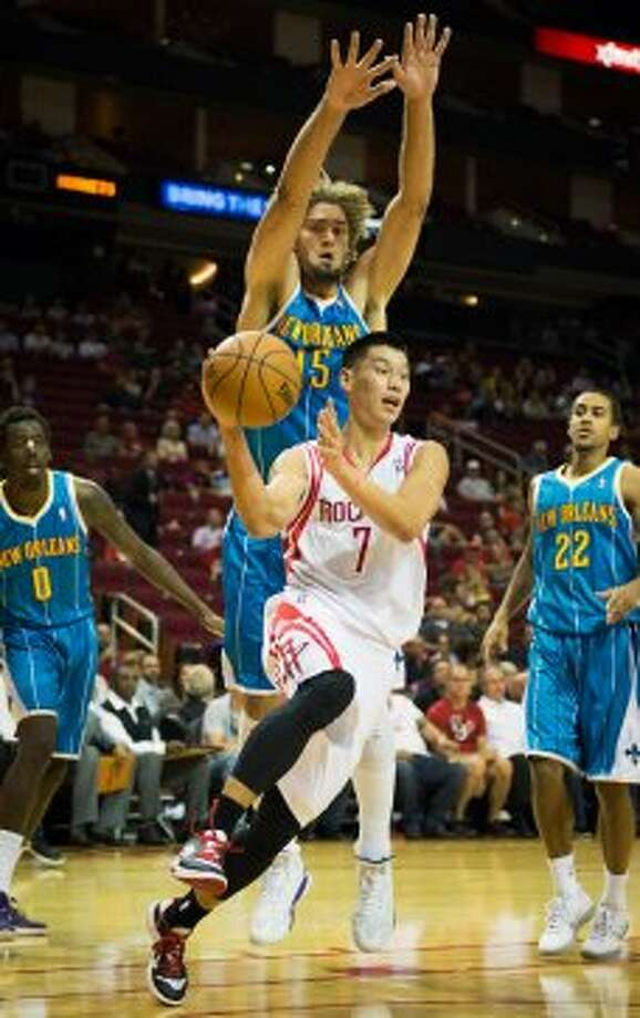 Rockets guard Jeremy Lin drives to the basket past Hornets center Robin Lopez. (Smiley N. Pool / © 2012  Houston Chronicle)
