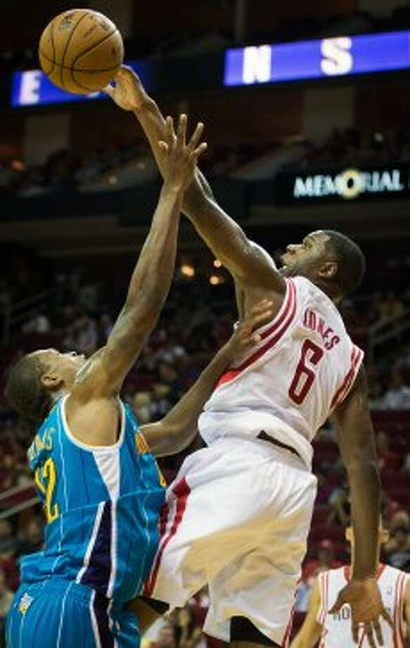 Rockets forward Terrence Jones blocks a shot by Lance Thomas of the Hornets. (Smiley N. Pool / © 2012  Houston Chronicle)