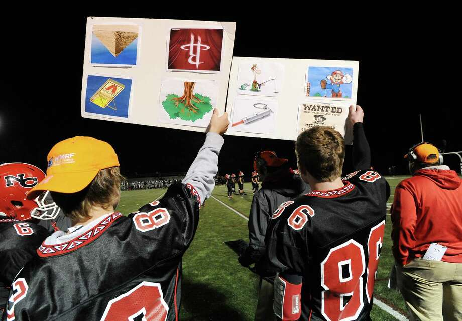 The New Canaan sideline during the high School football game between New Canaan High School and Norwalk High School at New Canaan, Friday night, Oct. 12, 2012. Photo: Bob Luckey / Greenwich Time