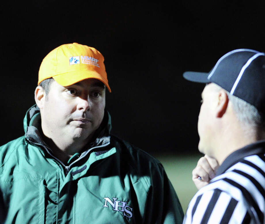 Norwalk Head Football Coach Sean Ireland, left, speaks with a ref during the high School football game between New Canaan High School and Norwalk High School at New Canaan, Friday night, Oct. 12, 2012. Photo: Bob Luckey / Greenwich Time