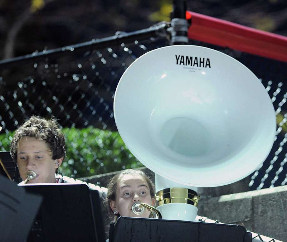 New Canaan High School tuba player Molly James, right,  plays with her school's band High School football game between New Canaan High School and Norwalk High School at New Canaan, Friday night, Oct. 12, 2012. Photo: Bob Luckey / Greenwich Time