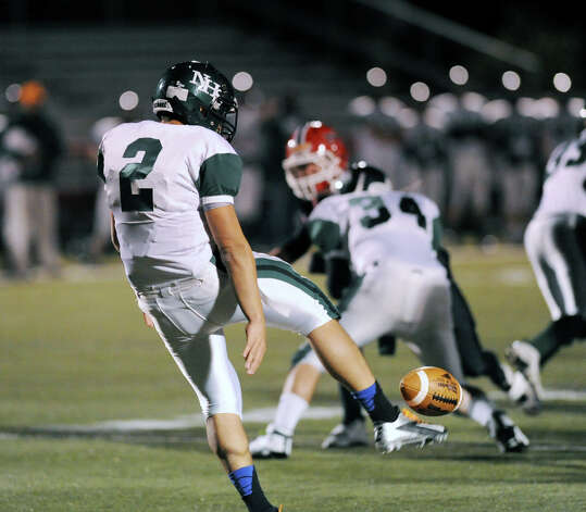 Andy Lovo # 2 of Norwalk punts during the high School football game between New Canaan High School and Norwalk High School at New Canaan, Friday night, Oct. 12, 2012. Photo: Bob Luckey / Greenwich Time