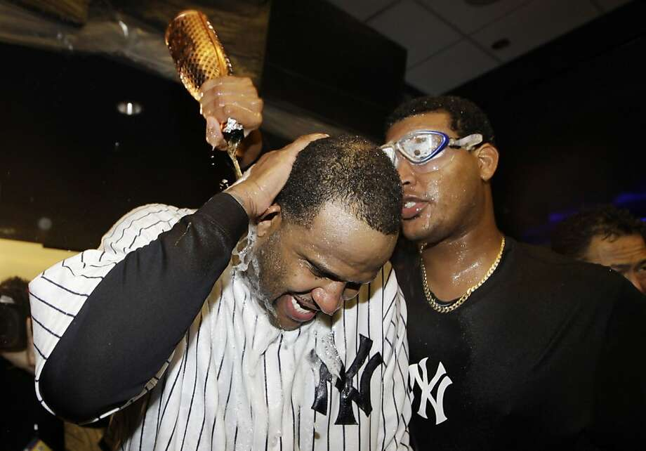 Ivan Nova administers a celebratory shower to winning pitcher CC Sabathia after the Yankees' series-deciding victory. Photo: Kathy Willens, Associated Press