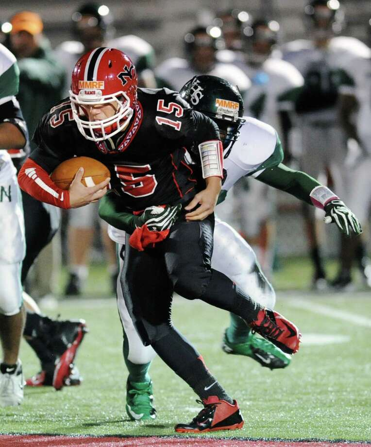 New Canaan quarterback Nick Cascione gets past a Norwalk defensive player during the high School football game between New Canaan High School and Norwalk High School at New Canaan, Friday night, Oct. 12, 2012. Photo: Bob Luckey / Greenwich Time