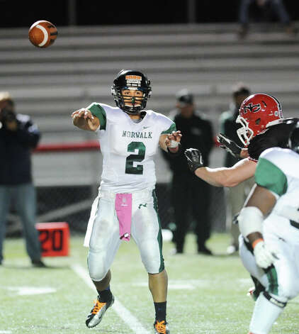 Norwalk quarterback Andy Lovo # 2 throws during the high School football game between New Canaan High School and Norwalk High School at New Canaan, Friday night, Oct. 12, 2012. Photo: Bob Luckey / Greenwich Time