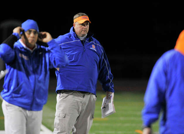 Danbury head football coach Dan Donovan paces the sidelines during the Hatters' game against Staples at Danbury High School on Friday, Oct. 12, 2012. Staples won, 51-6. Photo: Jason Rearick / The News-Times
