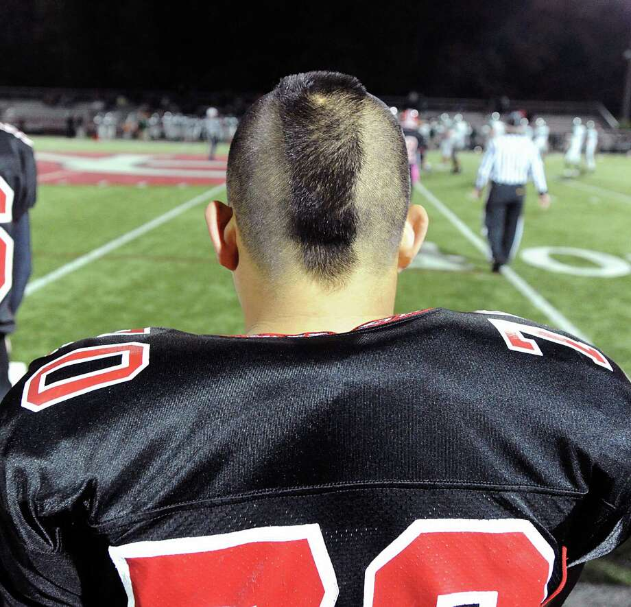 Brandon Pak # 70 of New Canaan during the High School football game between New Canaan High School and Norwalk High School at New Canaan, Friday night, Oct. 12, 2012. Photo: Bob Luckey / Greenwich Time