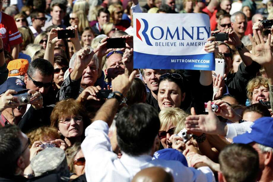 Republican presidential candidate, former Massachusetts Gov. Mitt Romney campaigns at the Mobility Supercenter in Richmond, Va., Friday, Oct. 12, 2012. (AP Photo/Charles Dharapak) Photo: Charles Dharapak