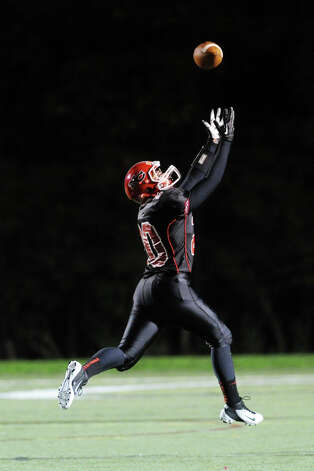 Andrew Read # 20 of New Canaan stretches out for a reception during the high School football game between New Canaan High School and Norwalk High School at New Canaan, Friday night, Oct. 12, 2012. Read did not make the catch. Photo: Bob Luckey / Greenwich Time