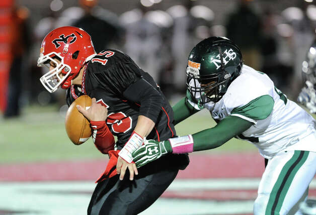 New Canaan quarterback Nick Cascione loses the ball on a hit by a Norwalk defensive player during the high School football game between New Canaan High School and Norwalk High School at New Canaan, Friday night, Oct. 12, 2012. Photo: Bob Luckey / Greenwich Time