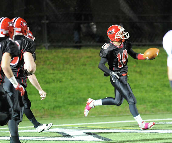 Casey Oullette # 18 of New Canaan after scoring on an interception during the high School football game between New Canaan High School and Norwalk High School at New Canaan, Friday night, Oct. 12, 2012. Photo: Bob Luckey / Greenwich Time