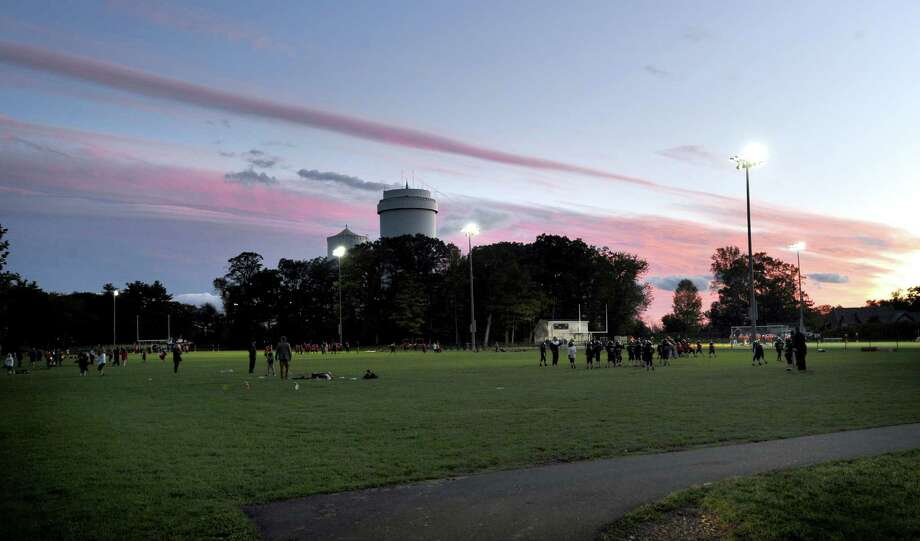 The twilight sky at New Canaan High School, Friday night, Oct. 12, 2012. Photo: Bob Luckey / Greenwich Time