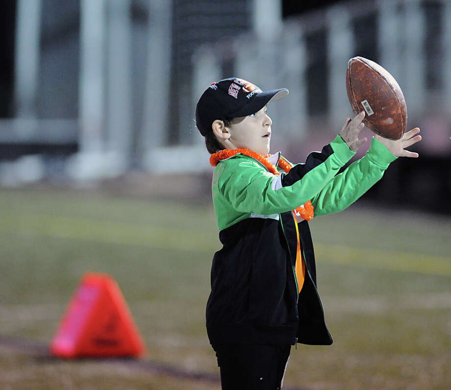 Mikey Gildea, 5, of New Canaan during the high School football game between New Canaan High School and Norwalk High School at New Canaan, Friday night, Oct. 12, 2012. Photo: Bob Luckey / Greenwich Time