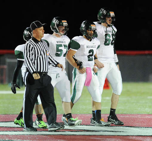 Norwalk football captains from left, Tristan Opdahl, # 57, Andy Lovo, #2, and Sean Butler # 68 during the high School football game between New Canaan High School and Norwalk High School at New Canaan, Friday night, Oct. 12, 2012. Photo: Bob Luckey / Greenwich Time