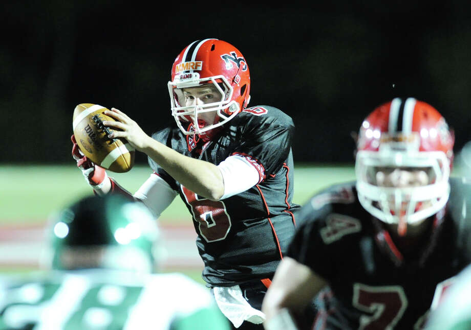 New Canaan's Teddy Bossidy # 6 takes the snap during the high School football game between New Canaan High School and Norwalk High School at New Canaan, Friday night, Oct. 12, 2012. Photo: Bob Luckey / Greenwich Time
