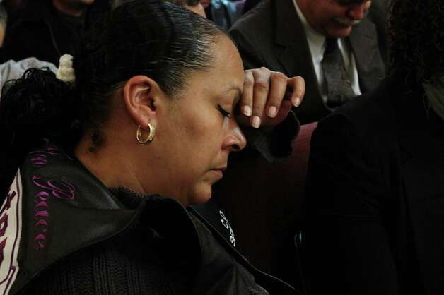 Cecilia Reyes closes her eyes during the funeral service for her son Noel Polanco Friday Oct. 12, 2012 at the Eternal Love Baptist Church in the Queens borough of New York.  Polanco, a 22-year-old Army National Guardsman, was shot to death by New York City police when he was pulled over for a traffic violation on Oct. 4 near LaGuardia Aiport. (AP Photo/Tina Fineberg) Photo: Tina Fineberg