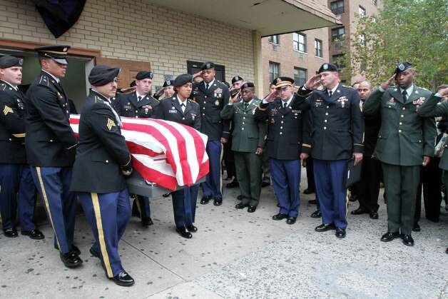 Jonathan Polanco, third from left, helps to carry out the body of his brother Noel Polanco following the funeral service for Noel Friday Oct. 12, 2012 at the Eternal Love Baptist Church in the Queens borough of New York.  Noel Polanco, a 22-year-old Army National Guardsman, was shot to death by New York City police when he was pulled over for a traffic violation on Oct. 4 near LaGuardia Airport. (AP Photo/Tina Fineberg) Photo: Tina Fineberg
